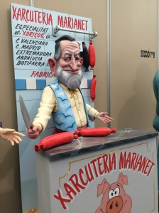 The President od Spain, Mariano Rajoy, as a butcher: cutbacks are quite usual in Spain at this moment.